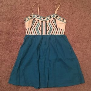 Fun turquoise and navy stitched mini dress